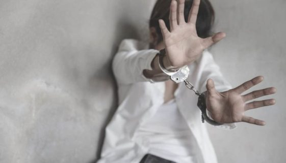 Woman Hands In Handcuffs, Human Trafficking Concept, Stop Violen
