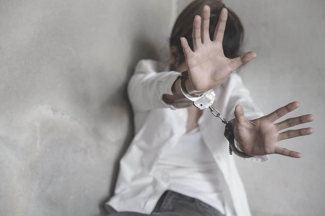Woman Hands In Handcuffs, Human Trafficking Concept, Stop Violen